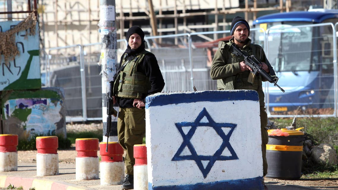 Israeli soldiers stand guard at the Gush Etzion junction in the West Bank following an attack. Tuesday, Jan. 5, 2016. AP)