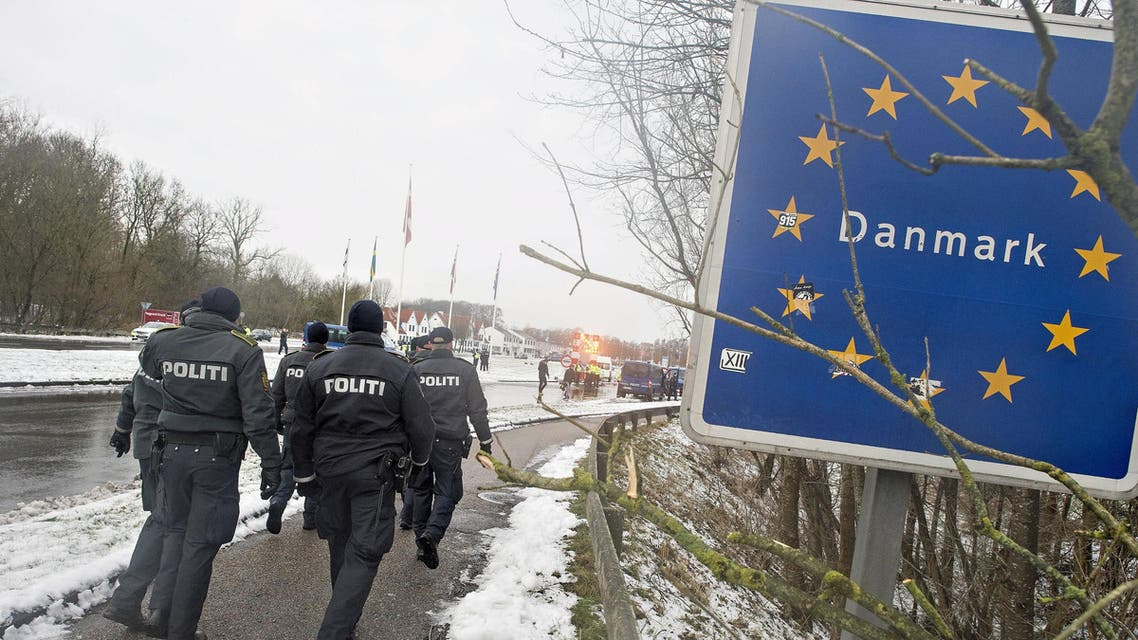 Police officers walk at the Danish-German border in Krusaa, Denmark January 9, 2016. The anti-Islamic group SIAD showed up to point out that the border should be completely closed. Counter-protest groups were also present. REUTERS/Claus Fisker/Scanpix DenmarkATTENTION EDITORS - THIS IMAGE WAS PROVIDED BY A THIRD PARTY. FOR EDITORIAL USE ONLY. NOT FOR SALE FOR MARKETING OR ADVERTISING CAMPAIGNS. THIS PICTURE IS DISTRIBUTED EXACTLY AS RECEIVED BY REUTERS, AS A SERVICE TO CLIENTS. DENMARK OUT. NO COMMERCIAL OR EDITORIAL SALES IN DENMARK. NO COMMERCIAL SALES.
