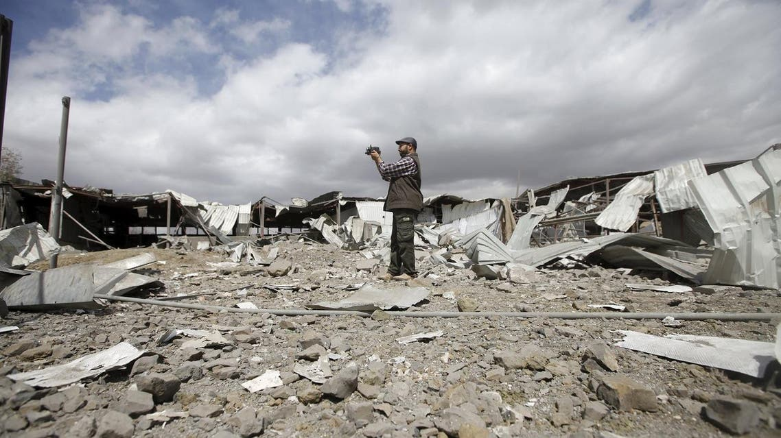 A man records damage at a tea factory after it was hit by Saudi-led air strikes in Yemen's capital Sanaa. (Reuters)