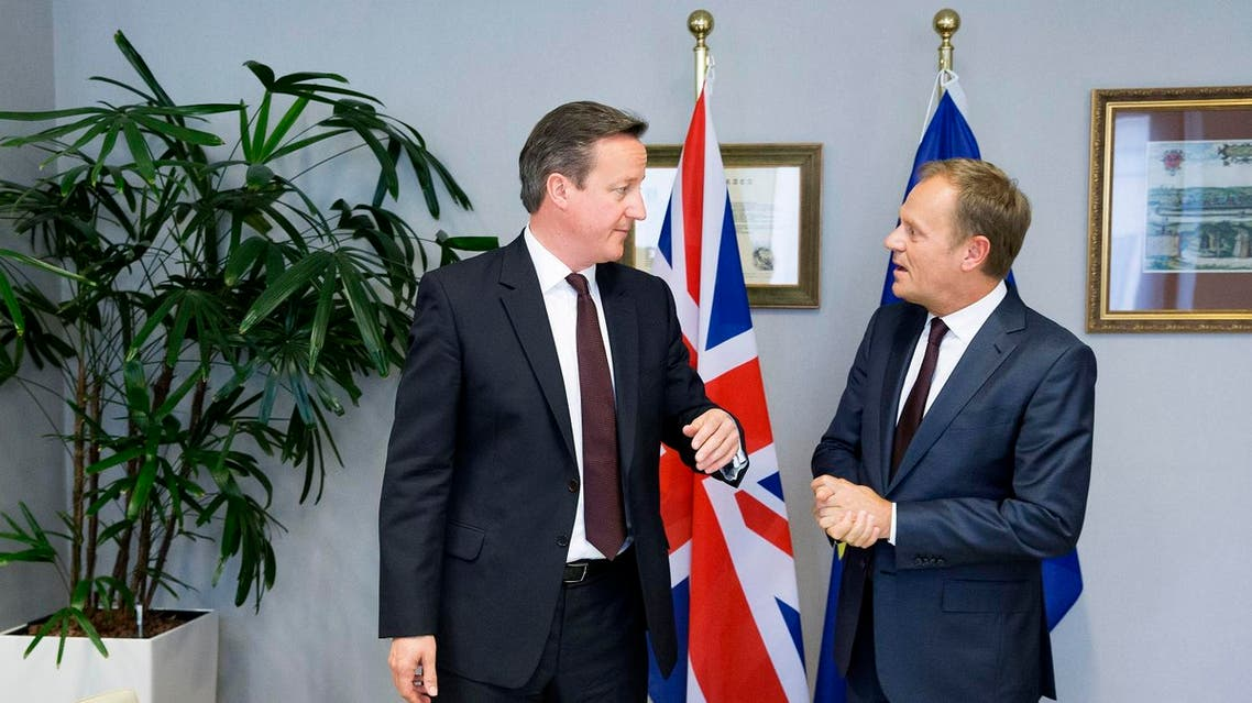 British Prime Minister David Cameron, left, speaks with European Council President Donald Tusk during a meeting on the sidelines of an EU summit in Brussels, on Thursday, June 25, 2015.
