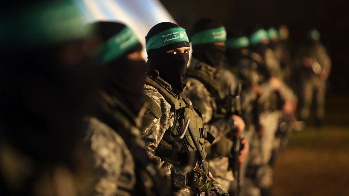 Palestinian members of the Ezzedine al-Qassam Brigades, the armed wing of the Hamas movement, take part in a gathering on January 31. (AFP)