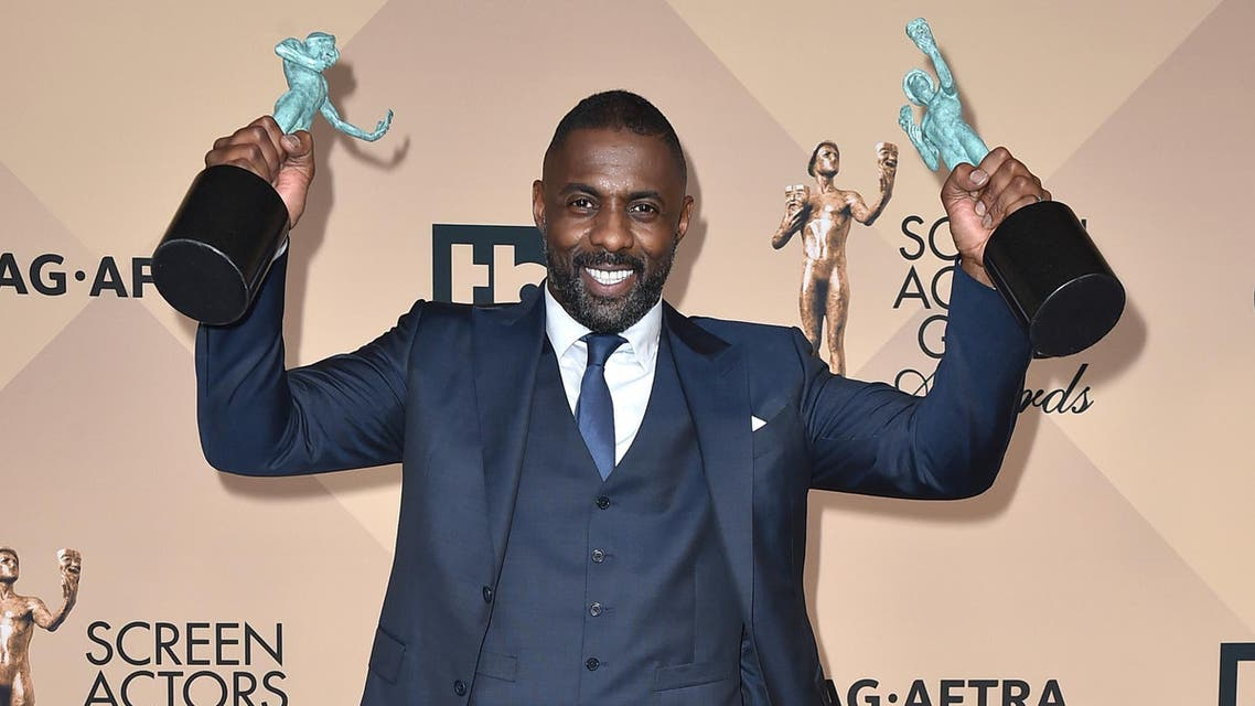 Idris Elba poses in the press room with the awards for outstanding male actor in 'Beasts of No Nation' and 'Luther' at the 22nd annual SAG Awards