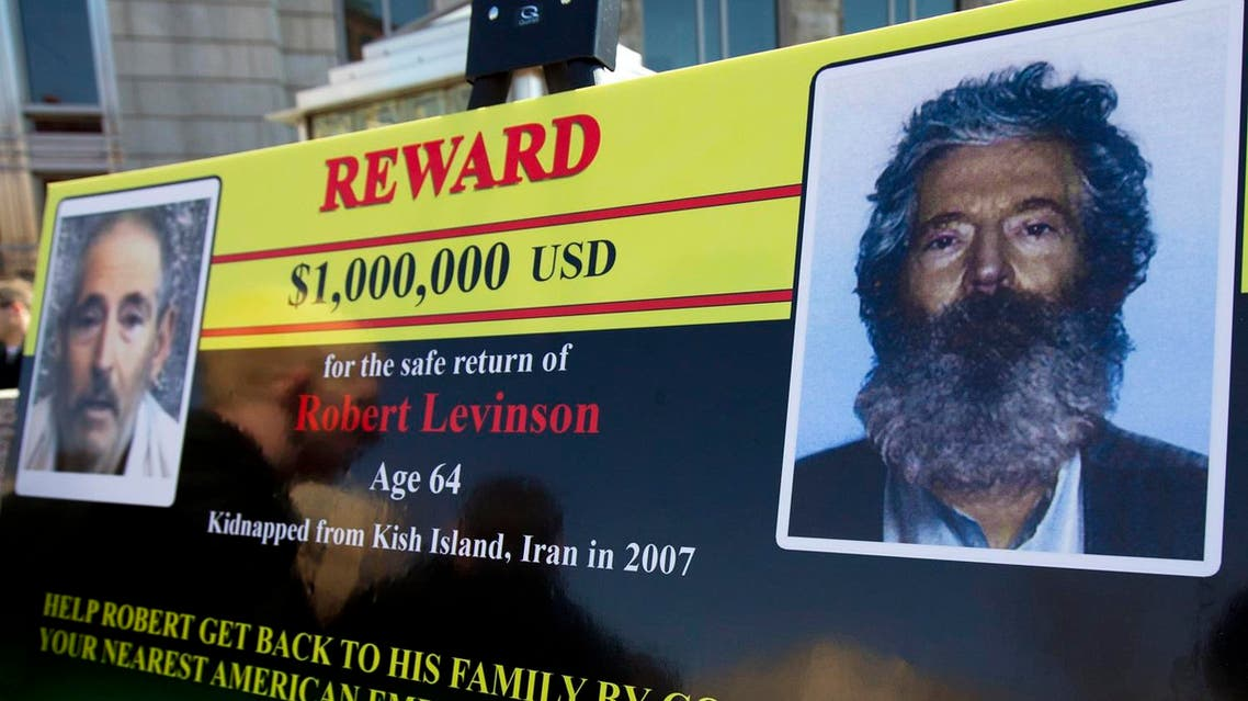 an FBI poster showing a composite image of former FBI agent Robert Levinson, right, of how he would look like after then-five years in captivity. (AP)