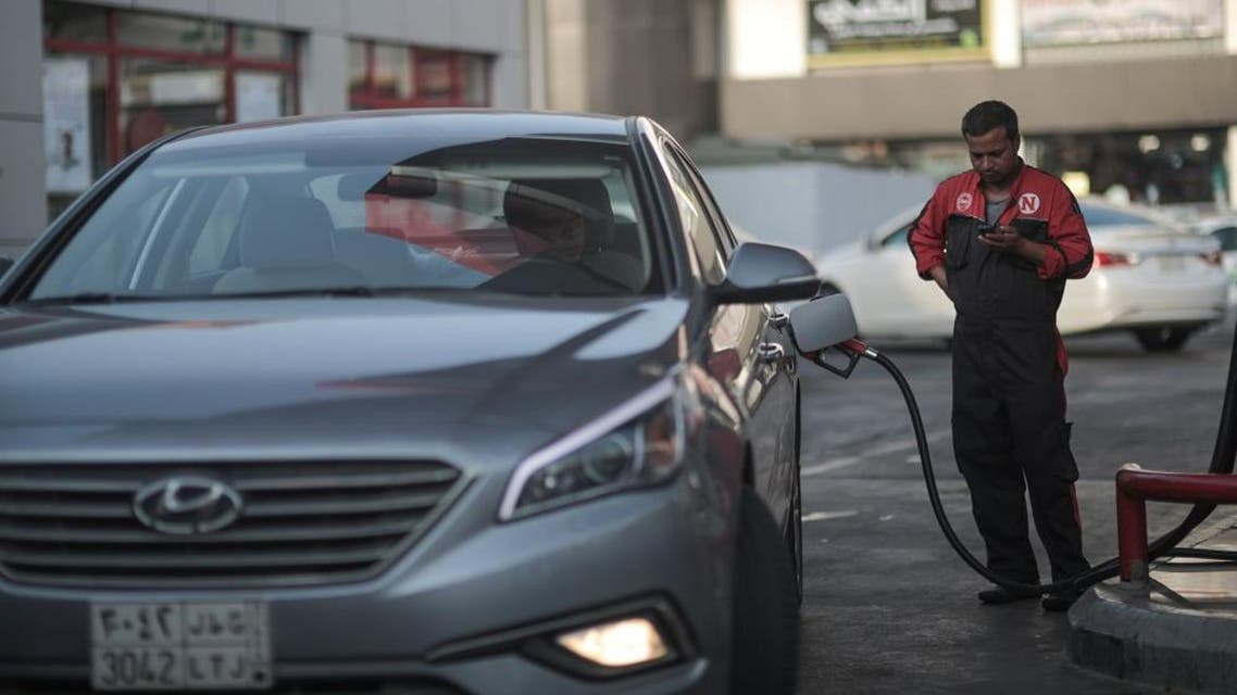 In this Wednesday, Sept. 16, 2015 file photo, a car fills up at a gas station in Jiddah, Saudi Arabia. The kingdom has announced on Monday, Dec. 28, 2015 a projected budget deficit in 2016 of $87 billion (327 billion riyals), as lower oil prices cut into the government's main source of revenue. (AP Photo/Mosa'ab Elshamy, File)