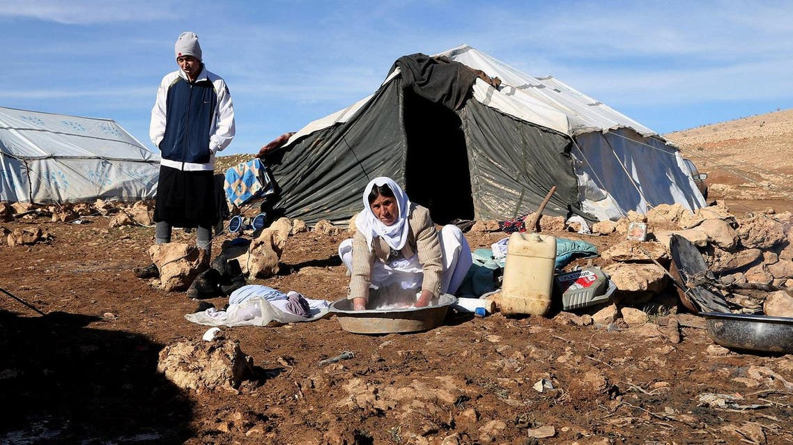 , Iraqis from the Yazidi minority gather outside their makeshift homes on Mount Sinjar in northern Iraq. (AP)