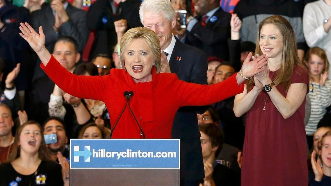 Former U.S. President Bill Clinton applauds his wife Democratic U.S. presidential candidate Hillary Clinton as they appear with their daughter Chelsea. (Reuters)