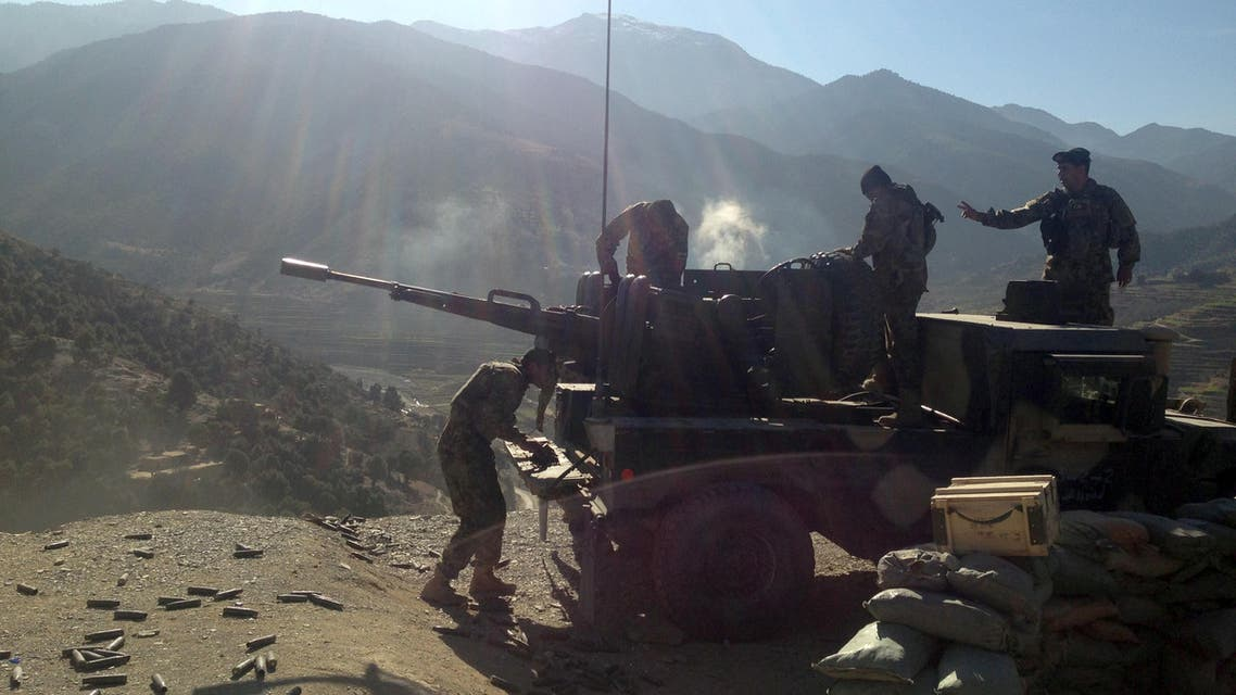In this Sunday, Dec. 28, 2014 photo, Afghan National Army soldiers open fire into mountains during an ongoing war, in the Dangam district of Kunar province, Afghanistan.  AP