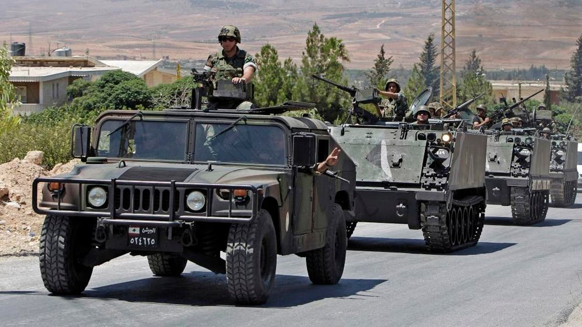In this Aug. 4, 2014, file photo, Lebanese army reinforcements arrive at an area on the outskirts of Arsal, a predominantly Sunni Muslim town near the Syrian border in eastern Lebanon. A roadside bomb exploded near an army patrol in Arsal, wounding at least three soldiers, the military said Friday, Nov. 14. (AP Photo/Bilal Hussein, File)
