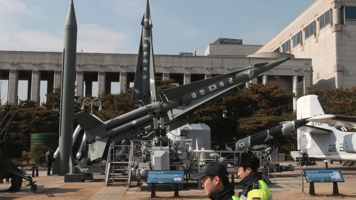 """Police officers walk by a mock Scud-B missile of North Korea, left, and other South Korean missiles on display at the Korea War Memorial Museum in Seoul, South Korea, Wednesday, Feb. 3, 2016. South Korea warned on Wednesday of """"searing"""" consequences if North Korea doesn't abandon plans to launch a long-range rocket that critics call a banned test of ballistic missile technology. (AP Photo/Ahn Young-joon)"""