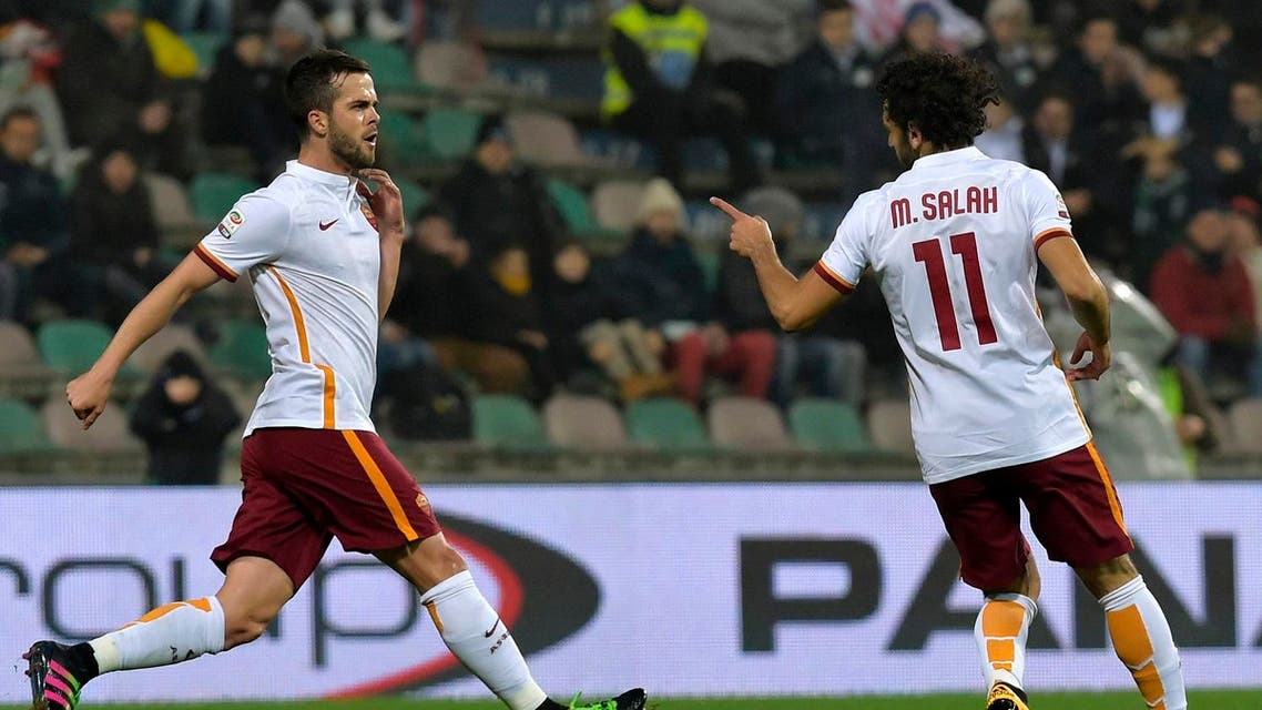 Roma's Mohamed Salah, right, celebrates with his teammate Miralem Pjanic, after scoring against Sassuolo during their Italian Serie A soccer match at Mapei stadium in Reggio Emilia, Italy, Tuesday, Feb. 2, 2016. AP