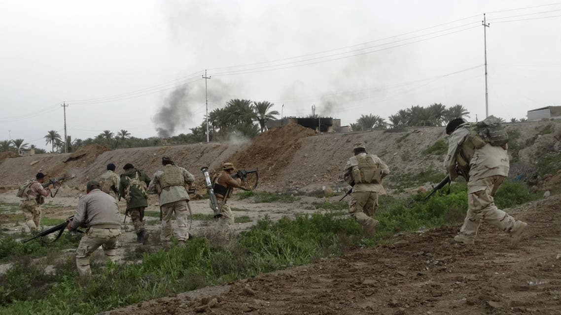 n this Friday, Jan. 22, 2016 photo, Iraqi security forces respond to an Islamic State group attack on their position in Ramadi, 70 miles (115 kilometers) west of Baghdad, Iraq. AP