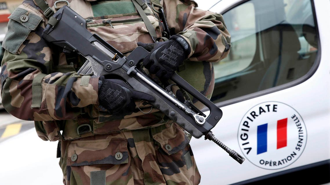 "A French Legionnaire holds his Famas assault riffle as he patrols as part of France's Vigipirate national security alert system ""Sentinelle"" in this picture taken January 20, 2016 in Nice, France. Thousands of demonstrators marched in France January 30, 2016 to protest against the government's plans to extend the state of emergency in the country. Picture taken January 20, 2016. REUTERS/Eric Gaillard/Files"