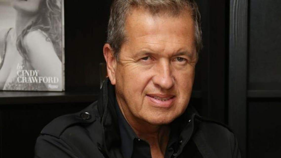 Mario Testino poses for photographs on arrival at Cindy Crawford's book launch at the Beaumont Hotel in central London, Thursday, Oct 1, 2015. (Photo by Joel Ryan/Invision/AP)