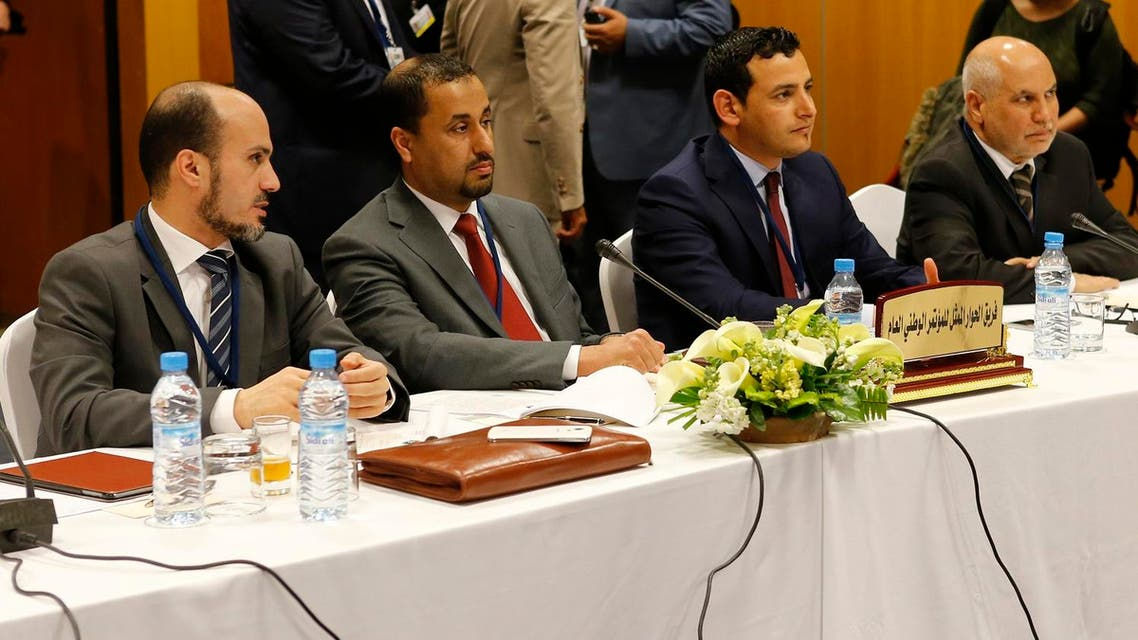 Dr. Saleh Almkhozom, Second Deputy Chairman of the General National Congress, 2nd left and Omar Hmeidan, spokesman for the GNC, 2nd right and members from the General National Congress legally-installed government in the capital, Tripoli, pose for photographers before the talks with UN Special Envoy to Libya Bernardino Leon at the Palais des Congres of Skhirate 30 km south of Rabat, Thursday, March 5, 2015. AP