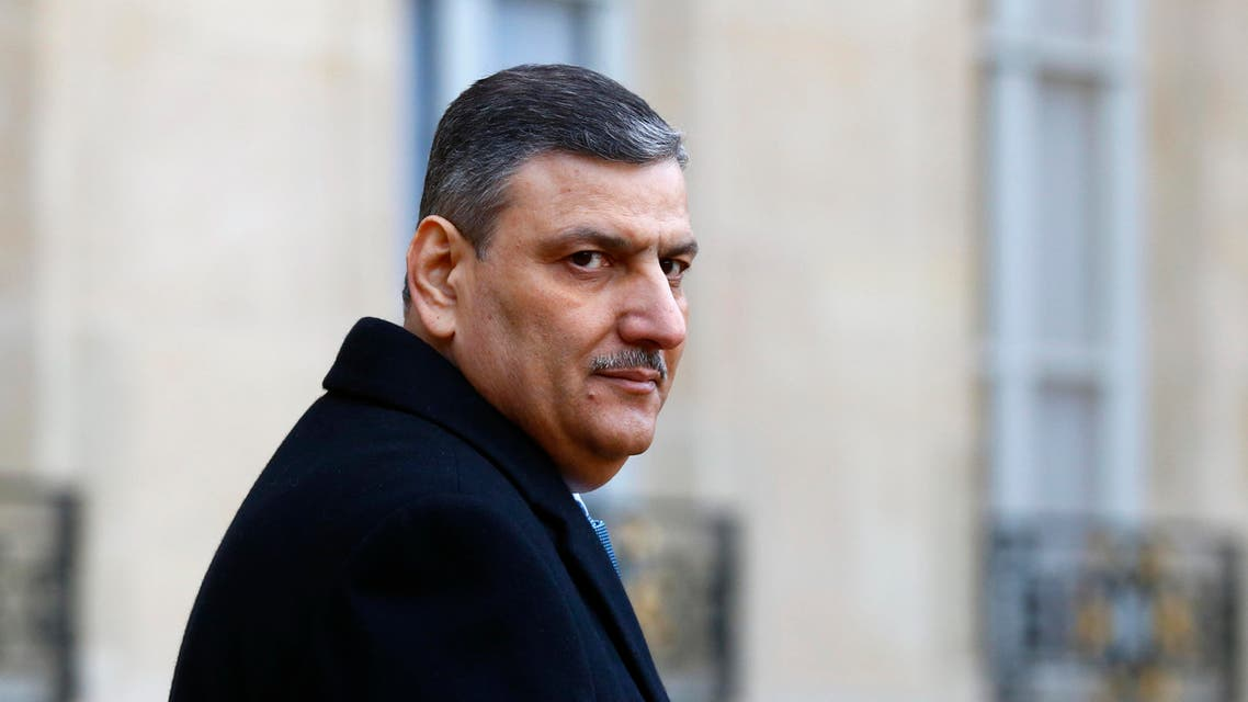 Former Syrian Prime Minister Riad Hijab, now coordinator of the Syrian opposition team walks to his car after his meeting with French President Francois Hollande at the Elysee Palace in Paris, Monday, Jan. 11, 2016. (AP Photo/Francois Mori)