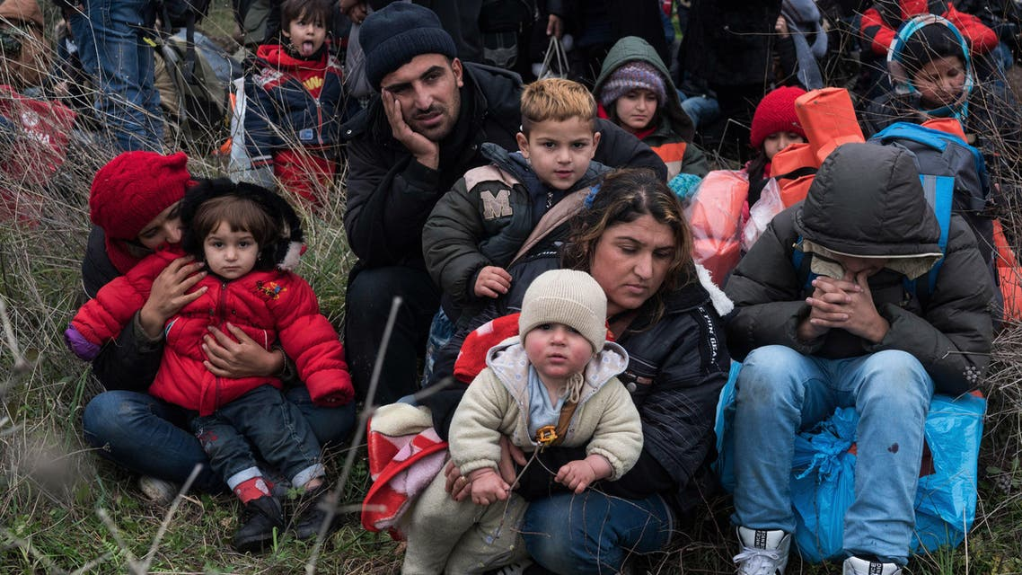 Migrants wait to travel to the Greek island of Lesbos, near the Aegean town of Ayvacik, Turkey, Friday, Jan. 29, 2016. AP