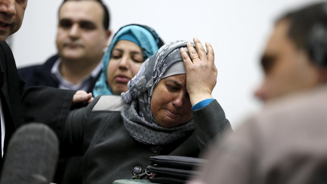Suha, mother of Palestinian youth, Mohammed Abu Khudair reacts after the sentencing of two of her son's murderers at the Jerusalem District Court in Jerusalem, February 4, 2016. REUTERS