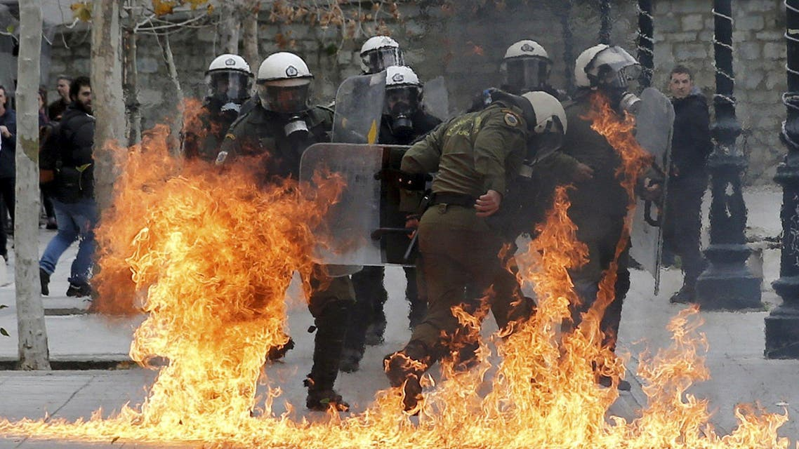 Riot police react to petrol bombs thrown by masked youths in Syntagma Square during a 24-hour general strike against planned pension reforms in Athens, Greece, February 4, 2016 reuters