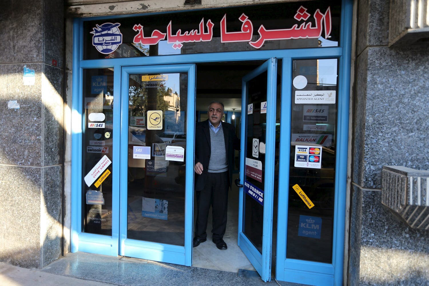 Palestinian travel agent Nabil Shurafa stands at the entrance of his office in Gaza City. (Reuters)