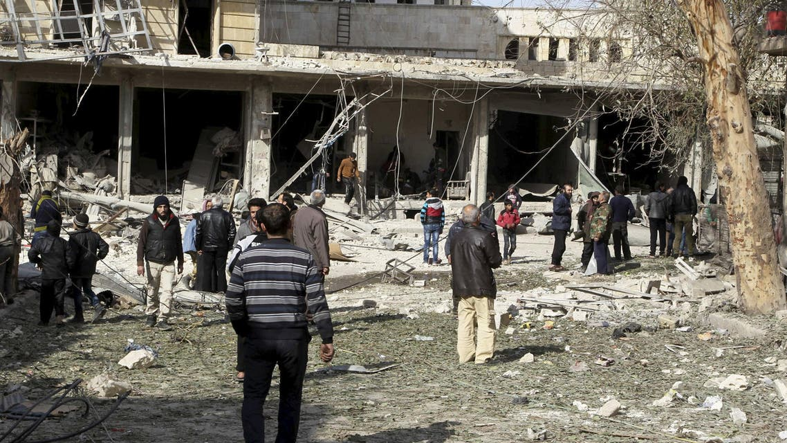 People inspect the damage after airstrikes by pro-Syrian government forces in the rebel held al-Sakhour neighbourhood of Aleppo, Syria February 5, 2016.  (Reuters)