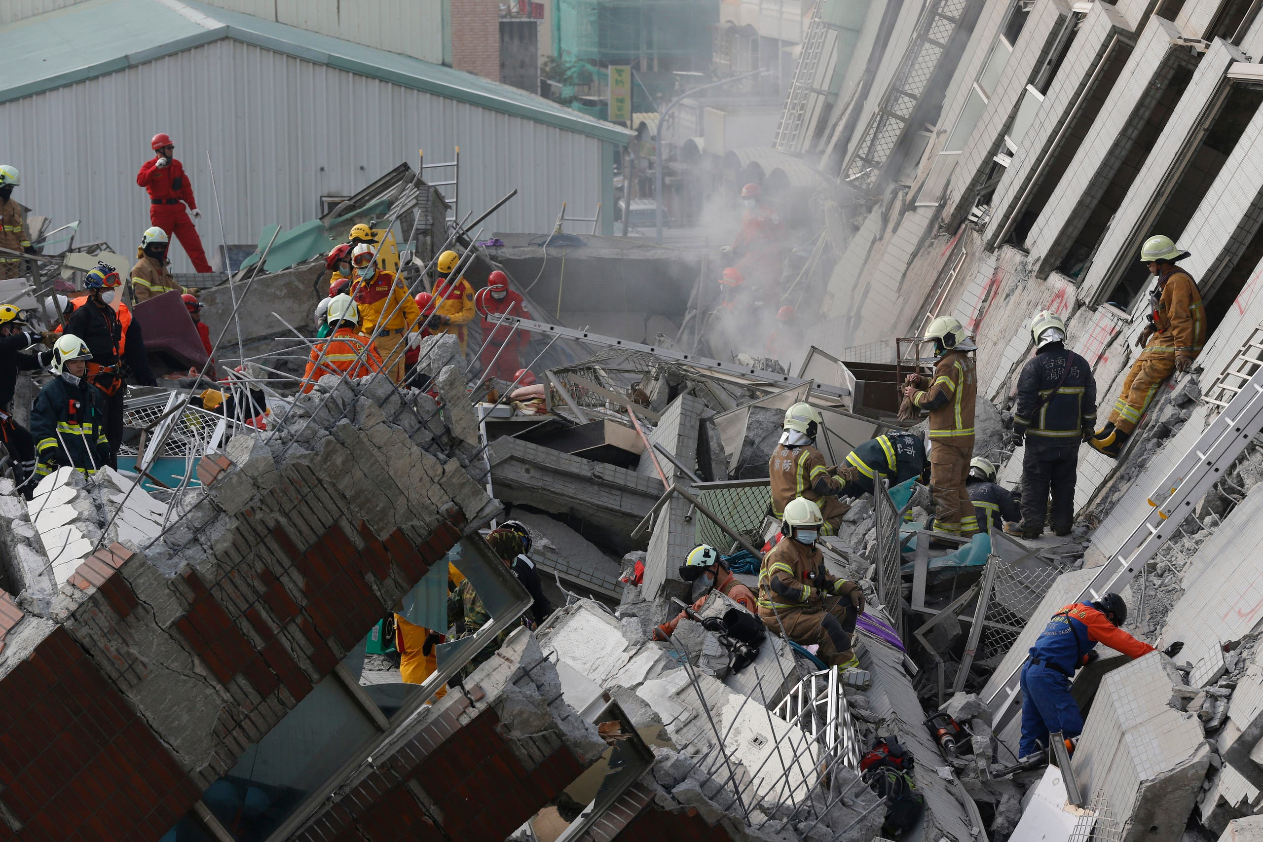 Rescue teams continue to search for the missing in a collapsed building, after an early morning earthquake in Tainan, Taiwan, Saturday, Feb. 6, 2016.  AP