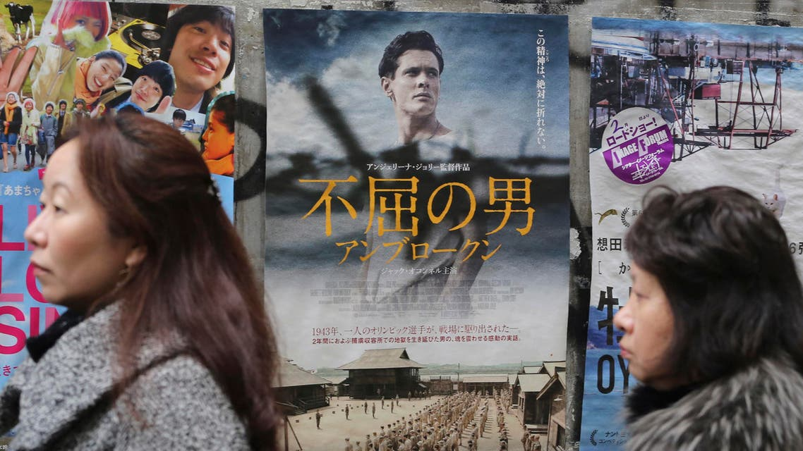 """Moviegoers wait before Angelina Jolie's """"Unbroken"""" opens in front of a movie theater in Tokyo, Saturday, Feb. 6, 2016. aP"""