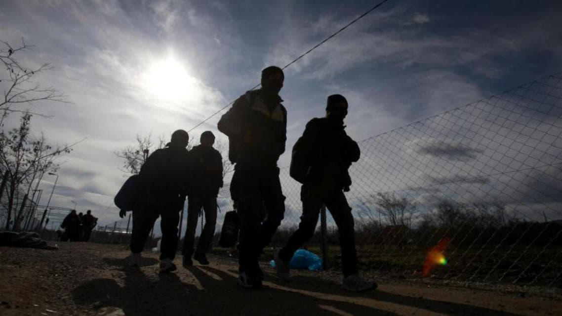 Refugees walk towards the border with Serbia from the transit center for refugees near northern Macedonian village of Tabanovce, Friday, Feb. 5, 2016. Macedonia accepts people only from war-affected zones who declare Austria or Germany as their final destination (AP)