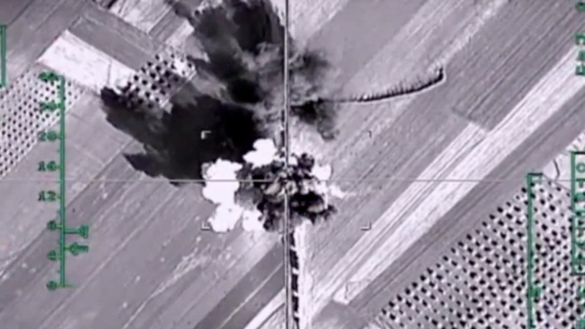 [Window Title] Save As  [Content]  In this photo made from the footage taken from Russian Defense Ministry official web site on Monday, Feb. 1, 2016, an aerial image shows what it says is a column of heavy trucks carrying ammunition hit by a Russian air strike near Aleppo, Syria. (AP) The file name is not valid.  [OK]