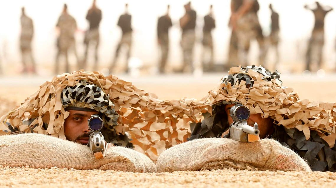 Members of Saudi special forces aim their guns during a training session in Darma, west of Riyadh. (File photo: Reuters)