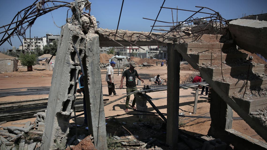 [Window Title] Save As  [Content] A Palestinian worker prepares rebar to rebuild a house which was destroyed during the last summer's war between Israel and Hamas, as the long-awaited reconstruction began in Shijaiyah neighborhood eastern Gaza City on Thursday, July 23, 2015. (AP) The file name is not valid.  [OK]