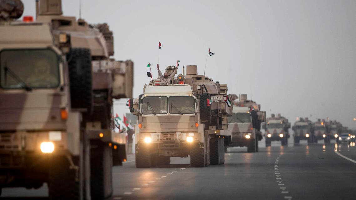 In this photo made available by the Emirates News Agency, WAM, a convoy of UAE military vehicles and personnel travels from Al Hamra Military Base to Zayed Military City, marking the return of the first batch of UAE Armed Forces military personnel from Yemen, United Arab Emirates, Saturday, Nov. 7, 2015. AP