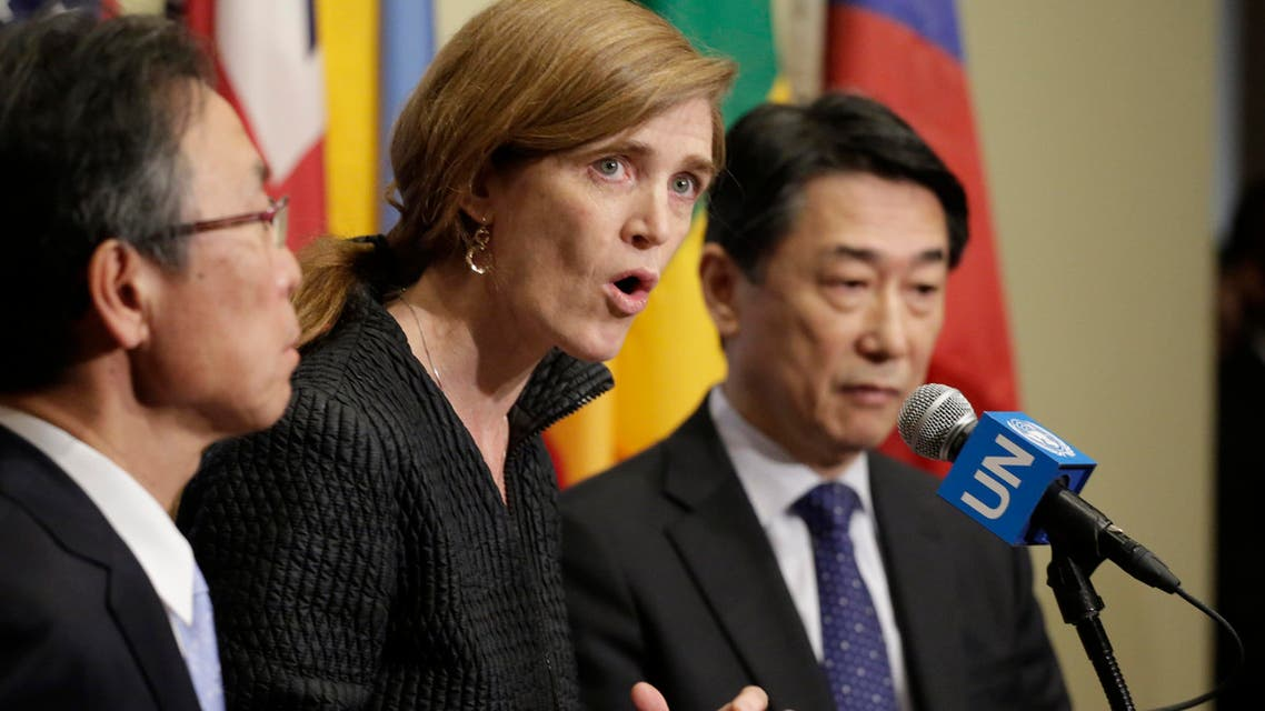 Motohide Yoshikawa, left, Japan's ambassador to the United Nations, and South Korea's Ambassador Oh Joon, right, listen as Samantha Power, center, the U.S. ambassador, makes comments to the media following a Security Council meeting at U.N. headquarters, Sunday, Feb. 7, 2016. AP
