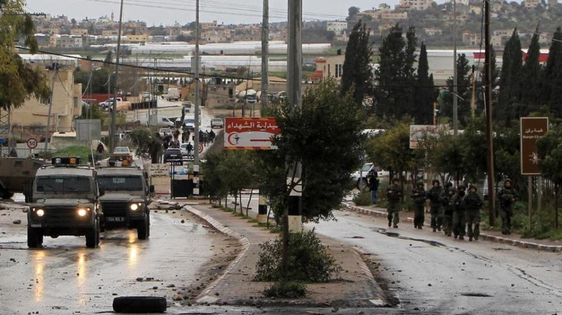 Israeli security forces advance in the village of Qabatiya, near the West Bank town of Jenin, during clashes with Palestinian protestors on February 6, 2016 (AFP)