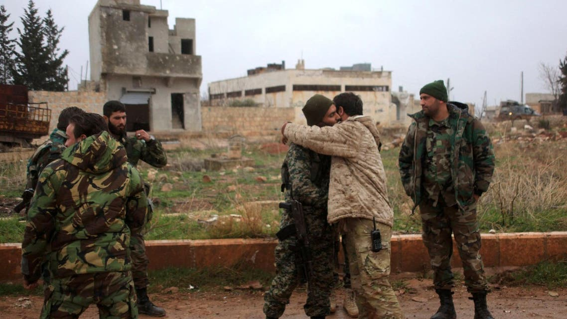 Syrian government soldiers celebrate after taking control of the village of Ratian, north of the embattled city of Aleppo, from rebel fighters on February 6, 2016. AFP