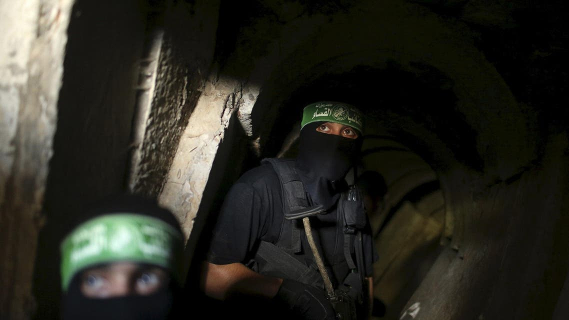 Palestinian fighters from the Izz el-Deen al-Qassam Brigades, the armed wing of the Hamas movement, are seen inside an underground tunnel in Gaza in this August 18, 2014 file photo. The Israeli government says its investigations have not come up with any evidence the night-time noises reported by villagers living near Gaza emanate from tunnels, but assertions by Hamas of extensive cross-border digging has only fueled concern. REUTERS/Mohammed Salem/Files