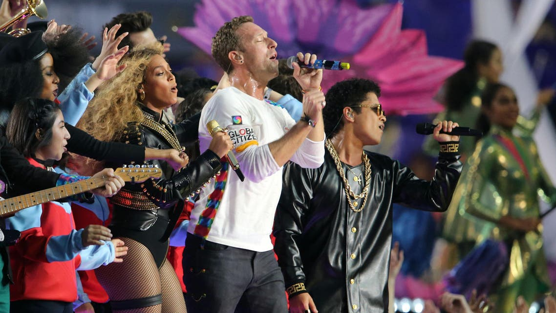 Coldplay singer Chris Martin (center), recording artist Beyonce (left), and recording artist Bruno Mars performs during halftime between the Carolina Panthers and the Denver Broncos in Super Bowl 50 at Levi's Stadium. (reuters)
