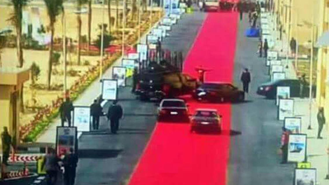 In this Saturday, Feb. 6, 2016 image taken from Egypt State TV, Egyptian President Abdel-Fattah el-Sissi's motorcade drives on a red carpet during a trip to open social housing projects in a suburb of Cairo, Egypt. AP