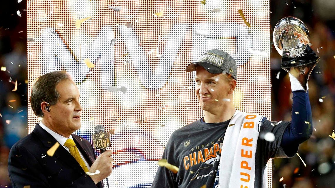 Denver Broncos' quarterback Peyton Manning is interviewed as he holds the Vince Lombardi Trophy after the Broncos defeated the Carolina Panthers in the NFL's Super Bowl 50 football game in Santa Clara, California February 7, 2016. Reuters