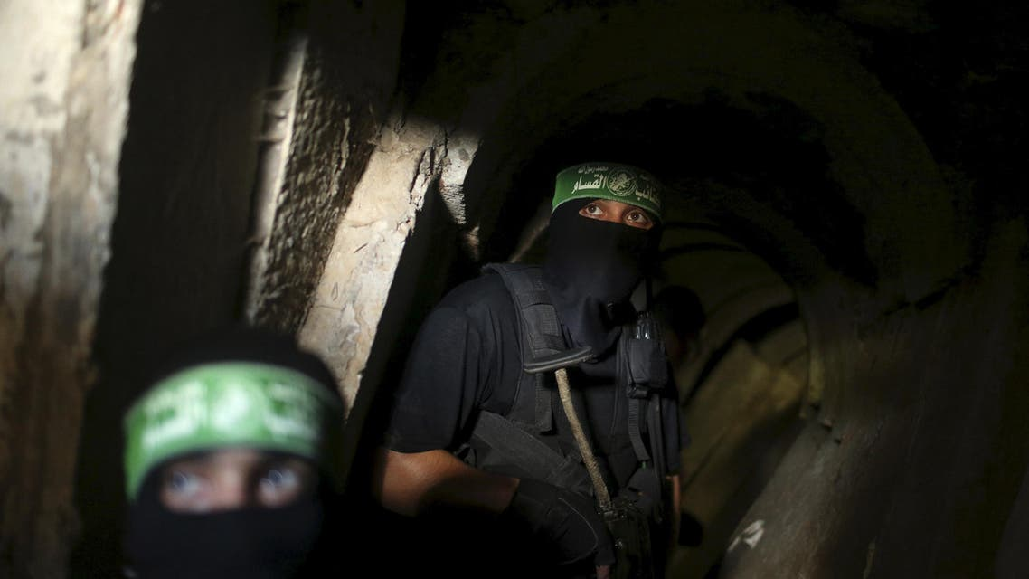 Palestinian fighters from the Izz el-Deen al-Qassam Brigades, the armed wing of the Hamas movement, are seen inside an underground tunnel in Gaza in this August 18, 2014 file photo. REUTERS