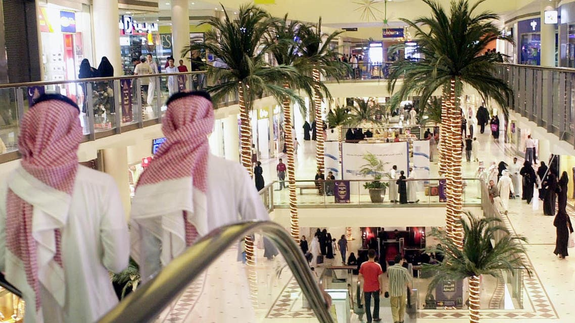 Saudis stroll in a shopping mall in Riyadh, Saudi Arabia, on Friday Oct. 31, 2003. Nightlife picks up during the Islamic holy month of Ramadan, with families heading to shopping malls, restaurants and visiting friends and relatives homes after breaking the day long fast. (AP Photo/Hasan Jamali)