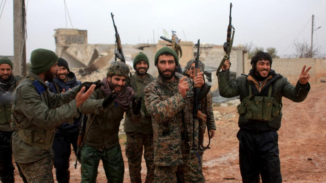 Ratian, Syria : Syrian government soldiers celebrate after taking control of the village of Ratian, north of the embattled city of Aleppo, from rebel fighters on February 6, 2016. Thousands of Syrians fled towards Turkey as regime troops pressed a major Russian-backed offensive around Aleppo, that threatens a fresh humanitarian disaster.