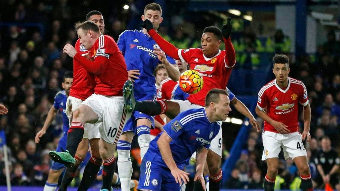 Players battle for the ball during the English Premier League soccer match between Chelsea and Manchester United at Stamford Bridge stadium in London, Sunday, Feb. 7, 2016. (AP Photo/Frank Augstein)