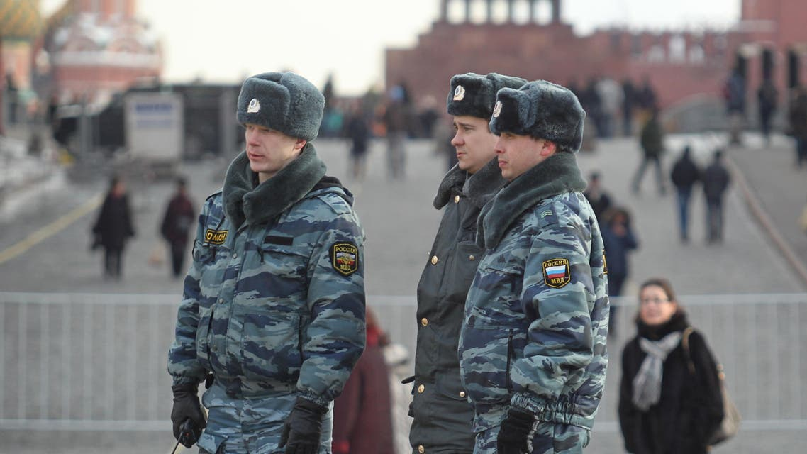 Russian police officers patrol at Red Square with the Lenin Mausoleum in the background, in Moscow, Russia, Saturday, March 3, 2012. (AP)