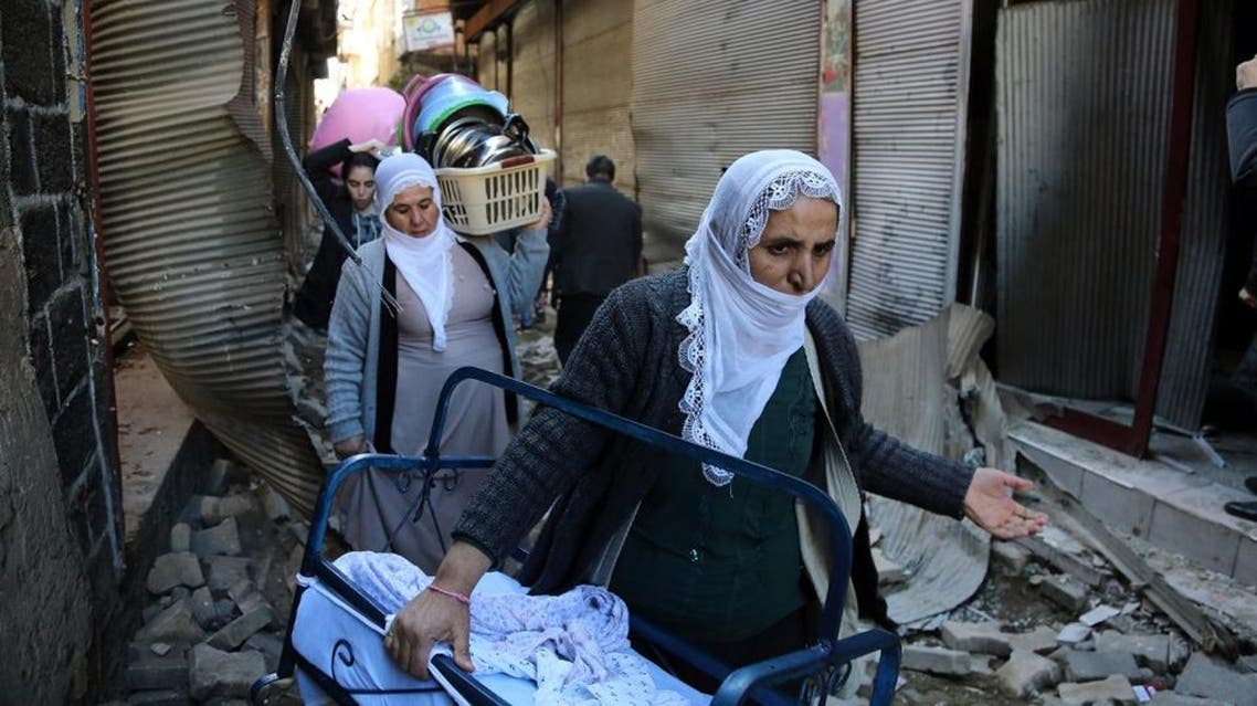 In this photo taken on Wednesday, Feb. 3, 2016, a family leaves the Sur district in Diyarbakir, Turkey. The family are among tens of thousands displaced by fighting raging between Turkish security forces and militants in the southeast after a peace process collapsed in the summer (AP)