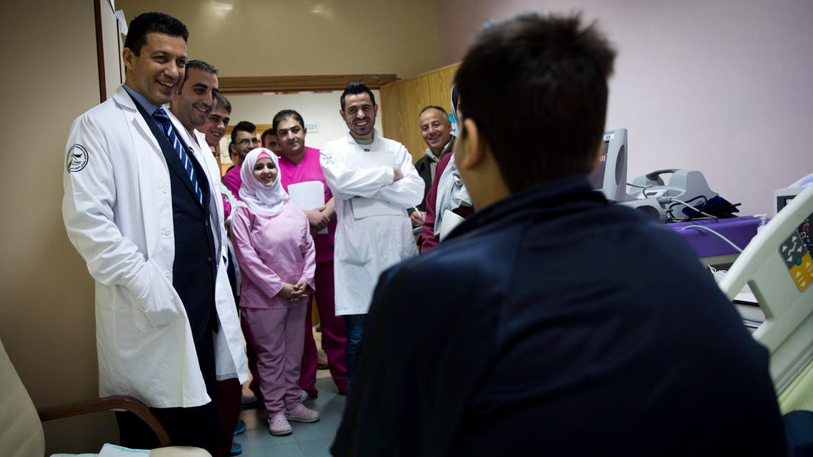 In this Thursday, Jan. 28, 2016 photo, Palestinian cardiovascular surgeon Saleem Haj-Yahia, left, visits 18-year-old Ahmad Sabareh recovering from heart transplant surgery at An-Najah University hospital in the West Bank city of Nablus.  (AP)
