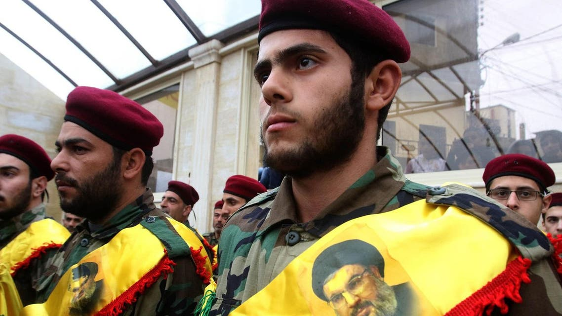 Members of Lebanon's militant Shiite Muslim movement Hezbollah attend the funeral of Ali Ahmed Sabra, a fellow militant who was killed in combat alongside Syrian government forces in Aleppo. (AFP)