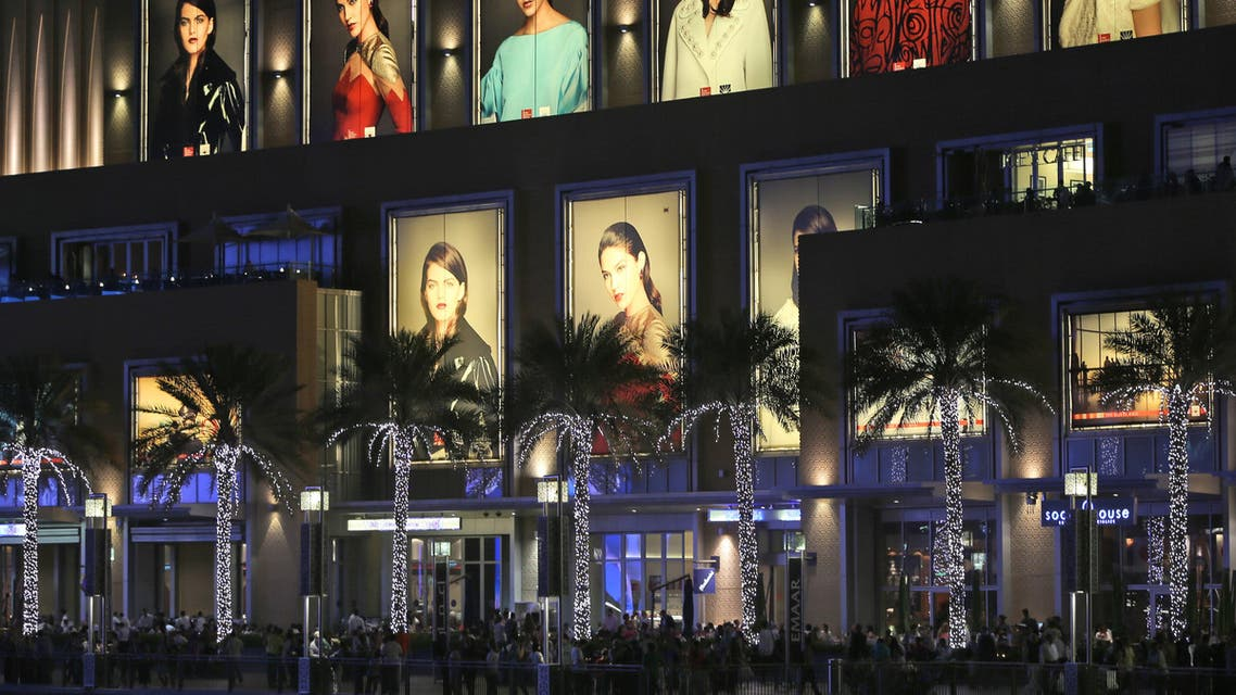 Tourists and visitor enjoy walking at the open space of Dubai Mall by the fountain in Dubai, United Arab Emirates, Monday, April 13, 2015. (AP)