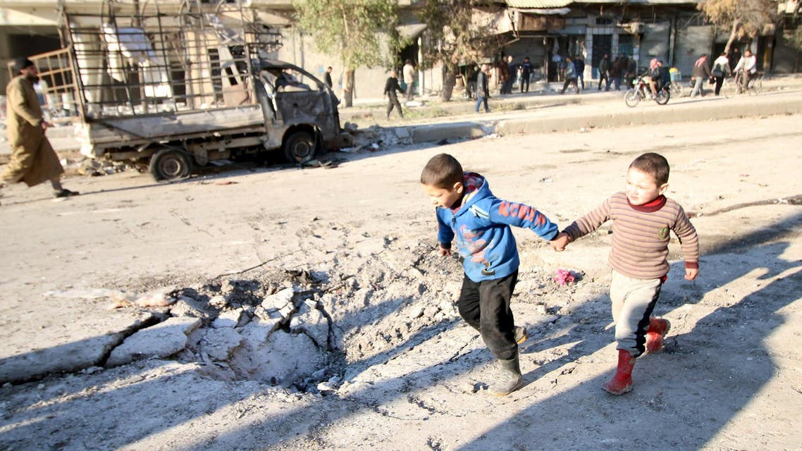 Boys run near a hole in the ground after airstrikes by pro-Syrian government forces in the rebel held al-Sakhour neighborhood of Aleppo, Syria February 8, 2016.  (Reuters)