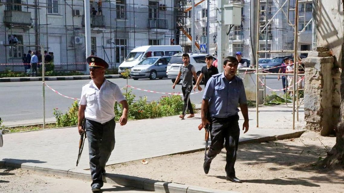 Police officers secure an area in the capital of Tajikistan, Dushanbe, where several Interior Ministry special forces officers and a traffic policeman were reportedly shot dead earlier on Friday, Sept. 4, 2015. (AP)
