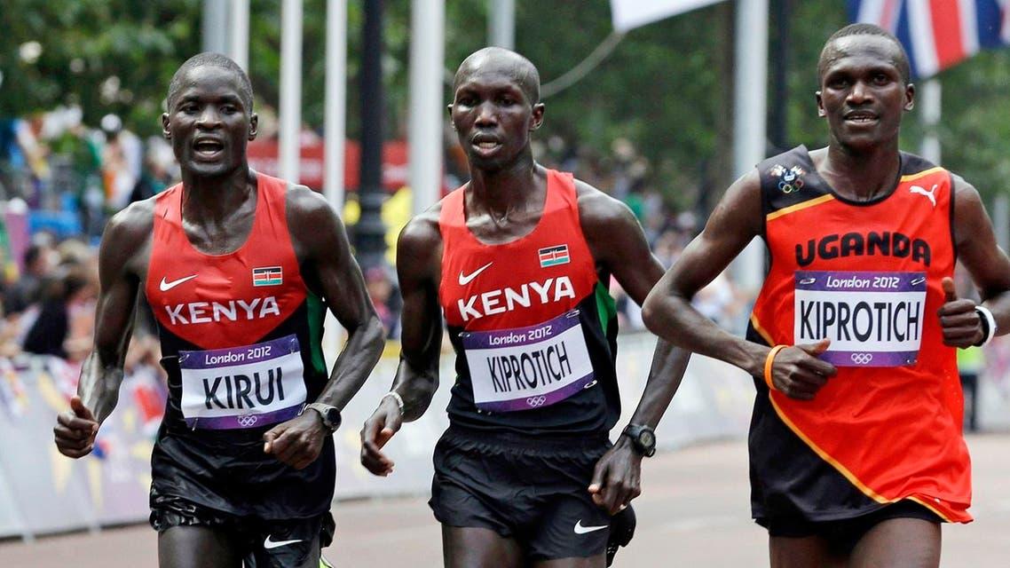 From left, silver-medallist Abel Kirui of Kenya, bronze-medallist Wilson Kipsang Kiprotich of Kenya, and gold-medallist Stephen Kiprotich of Uganda run during the men's marathon at the 2012 Summer Olympics in London. (AP)